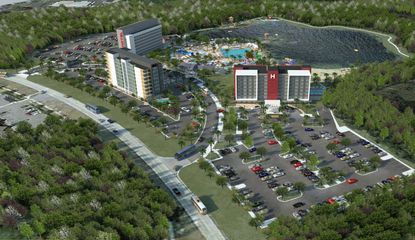 A new rendering showing an aerial view of AD1 Global's proposed three hotels and shared water park amenities along Bali Boulevard, in the Four Corners area.