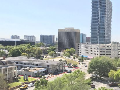 A partial view of the Travelodge and City Diner property at 409 N. Magnolia Ave. (outlined in red), from the Orange County Courthouse looking south in downtown Orlando toward Lake Eola.