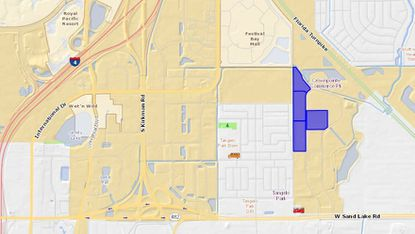 Highlighted in blue are four land parcels within Crownpointe Commerce Park on Kingspointe Way, northeast of the Tangelo Park neighborhood, being marketed for sale. The parcel on the right is Crownpointe II, home of the new warehouse lease for Amazon.