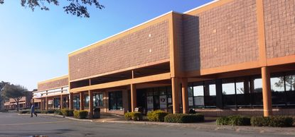 A new owner has cleaned up this neglected shopping center on Aloma Ave.