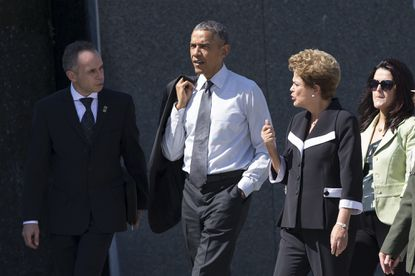 President Barack Obama walks with Brazilian President Dilma Rousseff, second from right, during a visit the Martin Luther King Jr. Memorial in Washington, Monday, June 29.