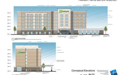 A view of the east elevation of the planned Holiday Inn & Suites on Regency Village Drive.