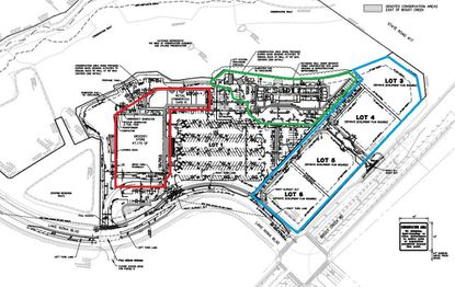 Outlined in green is the lot for a 120-room hotel at Tavistock's Lake Nona Creekside development, on the northwest corner of Lake Nona Boulevard and Boggy Creek Road. In red is the Publix-anchored retail center, and in blue four outparcel lots for future development.