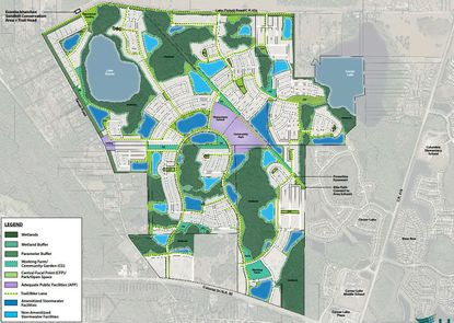The infrastructure map for green space within The Grow development planned in east Orange County, which is bordered to the north by Lake Pickett Road and to the south by S.R. 50. The light purple spaces in the center of the project were the former locations for the elementary school and public park.