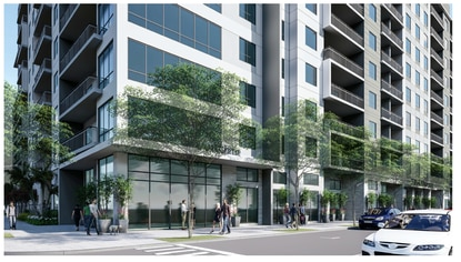 This street-level view shows the building as it would look from Orange Avenue. The current plan shows the leasing office and amenities on the the ground floor, but no retail. Corner units feature a wall of loft-style windows and large balconies.