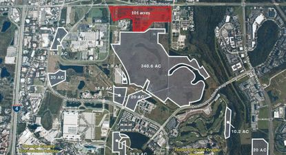 Highlighted in red are 101 acres along Sand Lake Road that a Universal Orlando affiliate acquired in October 2017, layered over a map of properties outlined in white that the company bought in December 2015 from Colony Capital.