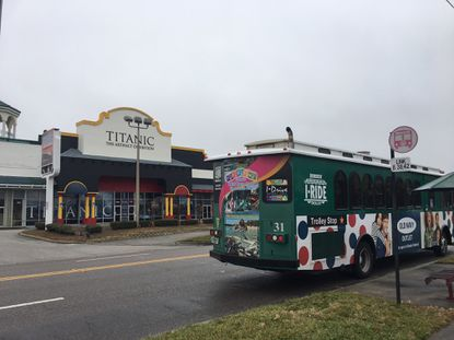 The I-Ride Trolley stops outside an attraction on N. International Drive in early January.