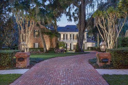 The reclaimed Chicago brick driveway and natural gas lanterns were inspired by New Orleans and Charleston architecture.