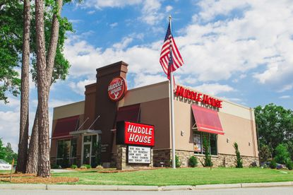 A view of the outside of a standalone Huddle House restaurant.