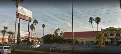 A dispute over the removal of this multi-tenant pole sign threatened to hold up the rezoning for a new Hilton flag hotel on Kissimmee's W192 corridor.