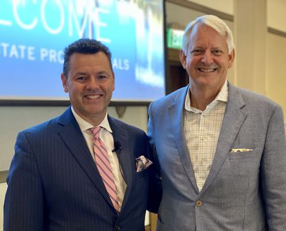 Pictured are Chris Christensen, broker/owner of Regal Real Estate Professionals, and Budge Huskey, CEO and President of Premier Sotheby's Inernational Realty.