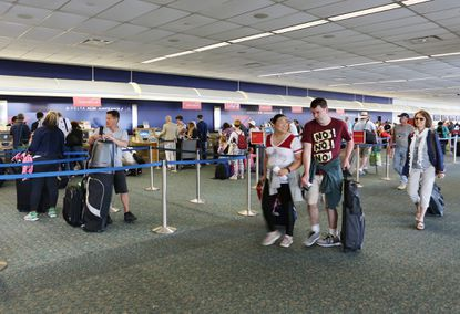 Thousands of passengers use the ticket counter at Orlando International Airport each day.