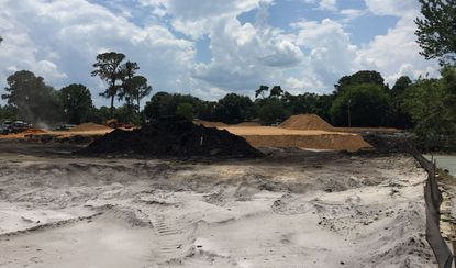 Dirt is moving on a site being developed for a Flowers Bakery distribution center.