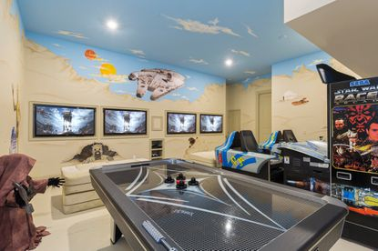The original owners found inspiration in their favorite movies for this game room, one of two in the 6,400-square-foot vacation home.
