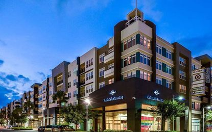 Marketing image of the Lofts at SoDo apartments on W. Grant Street in downtown Orlando.