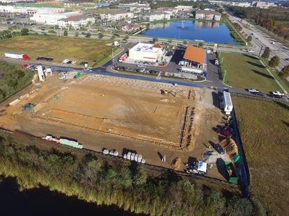 This aerial shows the construction site of a new My Neighborhood Storage center, on the corner of the Millenia Boulevard and John Young Parkway intersection.