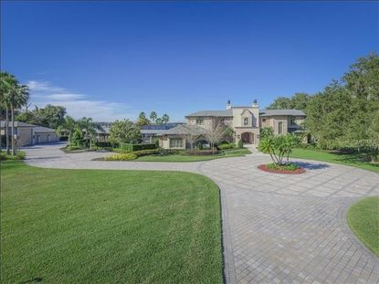 The recently sold property on Daetwyler Drive, which includes a 3.7-acre estate on Lake Conway, and a 7,158-square-foot home.
