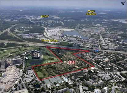 Nearly 50 acres of undeveloped property that fronts I-4, directly across the interstate from Disney Springs, has been marketed for major hotel development.