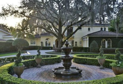 Hub International chairman & real estate agent buy Winter Park lakefront home