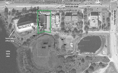 Outlined in green is the 3.36 acres of upland area at 7212 W. Sand Lake Road proposed for development as a new self storage facility.