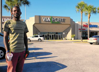 Antonio Louis, 27, of Leesburg, stands outside the newly named Via Port Florida Mall, formerly Lake Square Mall.