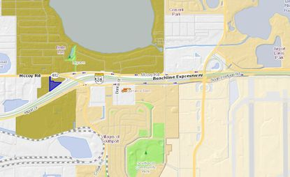 Highlighted in blue is a land parcel recently acquired by Woodspring Hotels, which plans to build a hotel 3.6 miles west of Orlando International Airport.