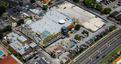 An aerial view of the Mango's Cafe Orlando property on International Drive, now under construction, with a cleared plot to the north of it where an accompanying parking garage will be built.