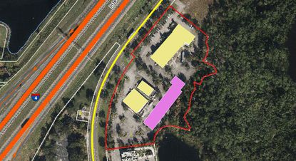The Premium Shoppes retail center is made up of three retail buildings (yellow) at 8600 Vineland Avenue. The developer is proposing to build workforce housing directly behind the buildings (purple).
