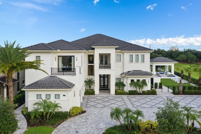 This nine-bedroom vacation home sits on a triple lot on Reunion's Golden Bear Drive overlooking the Jack Nicklaus Legends golf course.