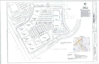 A site plan for Posner Village shows five anchor retail big box stores ranging from 10,000 square feet to 57,400 square feet, plus eight 1-acre outparcels.