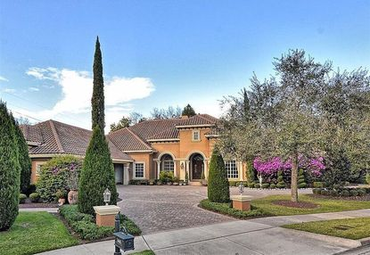 A 6,372-square-foot home recently bought in Longwood's Alaqua Lakes neighborhood by the new president and general manager of WESH-TV.