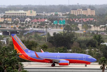A Southwest jet navigates the cross-taxi jet bridge at Orlando International Airport.