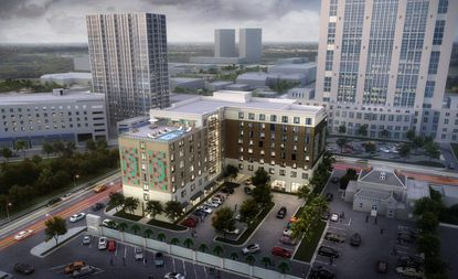 A rendering of the dual-branded Hilton Garden Inn and Home2 Suites hotel underway in downtown Orlando.