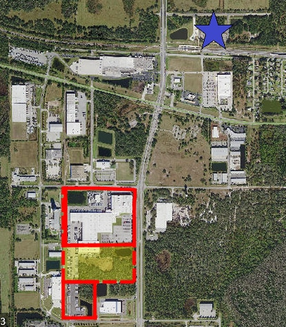 Highlighted in yellow is the 22-acre site where McLane Suneast plans to expand its grocery distribution facility by over 200,000 square feet. The Poinciana SunRail station, marked by the blue star, is about a half mile away.