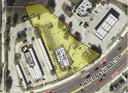 Highlighted in yellow is the 0.84-acre parcel on N. International Drive planned for an Andy's Frozen Custard, with its building site plan, parking and drive-thru lane imposed on the aerial.